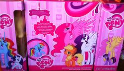 Size: 800x457 | Tagged: safe, applejack, fluttershy, pinkie pie, rainbow dash, rarity, sweetie belle, twilight sparkle, alicorn, pegasus, pony, unicorn, alicornified, bootleg, fluttercorn, hilarious in hindsight, irl, misspelling, photo, pinkiecorn, race swap, rainbowcorn, raricorn, toy, unicorn twilight, xk-class end-of-the-world scenario