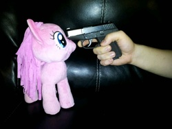 Size: 800x600 | Tagged: funrise, gun, irl, photo, pinkie pie, plushie, safe, toy, toy abuse, weapon
