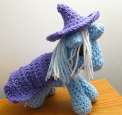 Size: 2461x2320 | Tagged: amigurumi, artist:kaerfel, cape, clothes, crochet, hat, irl, photo, plushie, pony, safe, solo, trixie, trixie's cape, trixie's hat