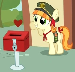 Size: 461x441 | Tagged: safe, screencap, tag-a-long, just for sidekicks, cropped, donation box, filly guides, grin, heart, smiling, solo, tail bow, thin mint