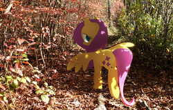 Size: 1024x655 | Tagged: safe, artist:dawnfire, fluttershy, colored pupils, forest, irl, looking at you, looking back, looking back at you, photo, ponies in real life, wood