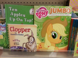 Size: 960x720 | Tagged: safe, applejack, donkey, earth pony, pony, book, clopper, clopper the christmas donkey, dr. seuss, juxtaposition, juxtaposition win, looking at you, meta, photo, ten apples up on top