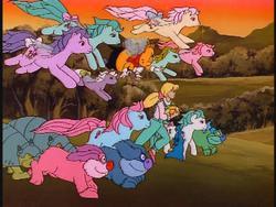 Size: 640x480   Tagged: safe, baby cuddles, cupcake (g1), forget me not, honeysuckle, hugster, lily (g1), megan williams, morning glory, peach blossom, rosedust, bushwoolie, flutter pony, human, pony, stoneback, my little pony 'n friends, blue furbob, charge, charging, furbob, g1, green furbob, pink furbob, queen rosedust, sting, sunstone (g1 artifact)