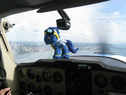 Size: 2592x1944 | Tagged: artist needed, safe, soarin', cockpit, interior, irl, photo, plane, plushie, ponies around the world, toy