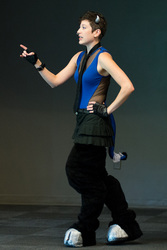 Size: 668x1000   Tagged: safe, artist:isaunter, iron will, human, bronycon, 2014, convention, cosplay, female, irl, irl human, male, microphone, photo, rule 63, solo, stage