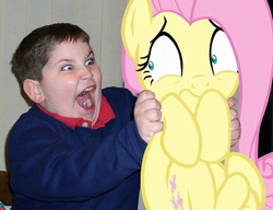 Size: 600x460 | Tagged: safe, artist:dtkraus, fluttershy, human, pony, child, creepy, holding a pony, irl, irl human, photo, ponies in real life, red eye, scared, target demographic, terror, wat