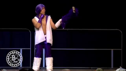 Size: 1334x750 | Tagged: safe, rarity, human, pony, bronycon, bronycon 2016, clothes, cosplay, costume, fur vest, irl, irl human, leg warmers, nxt, phone, photo, selfie stick, tyler breeze, wig, wwe
