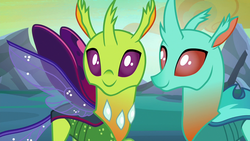 Size: 1280x720 | Tagged: safe, screencap, cornicle, changedling, changeling, to where and back again, background changeling, cute, cuteling, duo, spread wings, wings