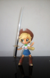 Size: 768x1200 | Tagged: safe, applejack, equestria girls, clothes, doll, equestria girls minis, eqventures of the minis, skirt, solo, sword, toy, weapon