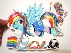 Size: 4320x3240 | Tagged: safe, artist:spirit-woods, rainbow dash, pegasus, pony, bucking, cake, candy, clothes, cute, denim skirt, female, food, football, leggings, lollipop, mare, marker drawing, shirt, skirt, solo, spread wings, sunglasses, traditional art