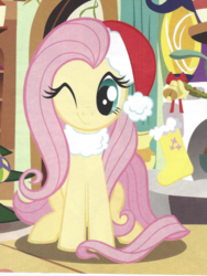Size: 365x486 | Tagged: safe, fluttershy, christmas, cute, female, fluttershy's cottage, hat, holiday, looking at you, magazine, magazine scan, mare, official, one eye closed, santa hat, scan, shyabetes, smiling, solo