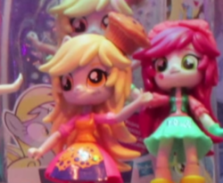 Size: 571x471 | Tagged: safe, derpy hooves, roseluck, equestria girls, clothes, doll, equestria girls minis, irl, photo, skirt, toy, toy fair, toy fair 2017