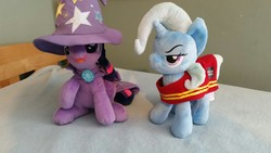 Size: 1328x747 | Tagged: artist needed, source needed, useless source url, safe, trixie, twilight sparkle, pony, unicorn, 4de, cape, clothes, female, hat, irl, mare, photo, plushie, swap, trixie's cape, trixie's hat, wells fargo