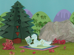 Size: 3983x2987 | Tagged: safe, artist:dori-to, artist:malte279, lyra heartstrings, pony, unicorn, comic:silly lyra, book, comic, comic book, craft, cute, eyes closed, featured image, grass, hoof hold, irl, kirigami, origami, papercraft, photo, prone, rock, silly lyra, smiling, solo, tree, tribute
