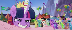 Size: 1920x800   Tagged: safe, screencap, blueberry field, bon bon, bunny moon, cornsilk, daisy, dawn sunrays, flower wishes, mellow dee, minuette, red gala, sweetie drops, twilight sparkle, wind whistler (g4), alicorn, earth pony, pegasus, pony, my little pony: the movie, apple family member, background pony, balloon, faic, female, grin, male, mare, market, not amethyst star, smiling, stallion, twilight sparkle (alicorn), unnamed character, unnamed pony