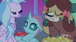 Size: 1920x1080 | Tagged: safe, screencap, ocellus, silverstream, yona, changedling, changeling, classical hippogriff, hippogriff, pony, yak, school raze, bow, chips, cloven hooves, eating, eyes closed, female, food, hair bow, jewelry, lidded eyes, monkey swings, nachos, necklace, prone