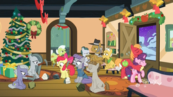 Size: 1920x1080 | Tagged: safe, screencap, apple bloom, applejack, big macintosh, cloudy quartz, grand pear, granny smith, igneous rock pie, limestone pie, marble pie, maud pie, mudbriar, sugar belle, earth pony, pony, best gift ever, apple family, bell, christmas, christmas tree, couch, discovery family logo, family, female, filly, food, garland, hearth's warming doll, hearth's warming tree, holiday, male, mare, mouth hold, pear, pickaxe, pie family, ponyville, present, rock, rug, shipping, sitting, stallion, straight, sugarmac, sweet apple acres, tree, wreath