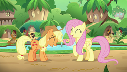 Size: 1280x720   Tagged: safe, screencap, applejack, autumn afternoon, fern flare, fluttershy, forest fall, maple brown, pumpkin smoke, earth pony, kirin, pegasus, pony, sounds of silence, background kirin, bucket, duo focus, eyes closed, female, fountain, kirin village, laughing, male, mare, raised hoof, sitting, water