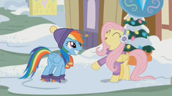 Size: 1350x757   Tagged: safe, screencap, fluttershy, rainbow dash, pegasus, pony, best gift ever, boots, clothes, cute, dashabetes, duo, earmuffs, hat, scarf, shoes, shyabetes, smiling, snow, sweater, winter, winter outfit