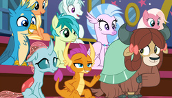 Size: 1824x1041 | Tagged: safe, screencap, amber grain, fuchsia frost, gallus, ocellus, sandbar, silverstream, smolder, snowy quartz, yona, changedling, changeling, classical hippogriff, dragon, earth pony, griffon, hippogriff, pony, unicorn, yak, a rockhoof and a hard place, background pony, bow, cloven hooves, colored hooves, dragoness, female, friendship student, hair bow, jewelry, malachite (sailor moon), male, mare, monkey swings, necklace, raised hoof, sitting, stallion, teenager