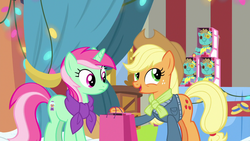 Size: 1280x720 | Tagged: applejack, bag, best gift ever, clothes, duo, earth pony, female, holly the hearths warmer doll, jacket, mare, minty bubblegum, pony, safe, scarf, screencap, unicorn
