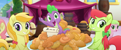Size: 1920x804   Tagged: safe, screencap, apple cobbler, carrot top, gala appleby, golden harvest, jonagold, marmalade jalapeno popette, peachy sweet, pink lady, red gala, spike, dragon, earth pony, pony, my little pony: the movie, apple family member, background pony, barrel, bow, faic, female, food, hair bow, happy, irrational exuberance, mare, quill, smiling, we got this together
