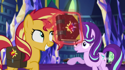 Size: 1280x720 | Tagged: safe, screencap, starlight glimmer, sunset shimmer, pony, unicorn, equestria girls, mirror magic, spoiler:eqg specials, book, discovery family logo, duo, female, grin, happy, it happened, journal, levitation, magic, mai waifus have met, mare, open mouth, smiling, telekinesis, twilight's castle