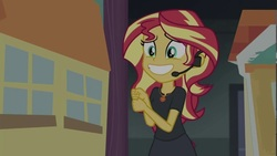 Size: 1280x720 | Tagged: safe, screencap, sunset shimmer, equestria girls, equestria girls series, opening night, amulet, fake smile, female, headset, smiling, solo, theater