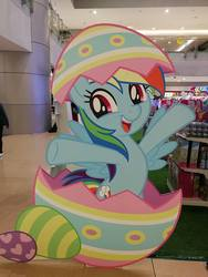 Size: 720x960 | Tagged: safe, rainbow dash, pegasus, pony, cardboard cutout, cute, dashabetes, easter, easter egg, egg, egghead, female, hatching, holiday, irl, mall, mare, philippines, photo, pun, solo, visual pun