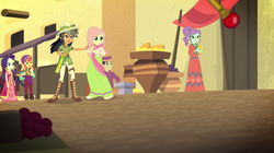 Size: 1912x1072 | Tagged: safe, screencap, chestnut magnifico, crystal lullaby, daring do, fluttershy, rarity, sunset shimmer, equestria girls, movie magic, spoiler:eqg specials, background human, clothes, dress, female, hat, india movie set, macuahuitl, pith helmet, robes, sari, sunshim, sword of altoriosa, sword of lusitano