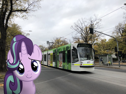 Size: 1024x768 | Tagged: artist:naijiwizard, city, cloud, cloudy, edit, female, irl, looking at you, photo, photoshop, ponies in real life, safe, smiling, starlight glimmer, tram, unicorn