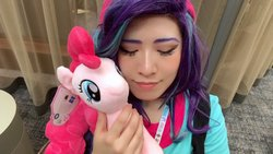 Size: 1280x720 | Tagged: safe, artist:nyakoppp, pinkie pie, starlight glimmer, human, pony, equestria girls, beanie, clothes, cosplay, costume, duo, eyes closed, hat, holding a pony, irl, irl human, photo, plushie