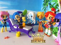 Size: 1500x1125 | Tagged: safe, artist:whatthehell!?, applejack, flash sentry, fluttershy, rarity, sci-twi, sunset shimmer, trixie, twilight sparkle, equestria girls, equestria girls series, alcohol, beach, beer, chair, clothes, dagger, doll, equestria girls minis, eqventures of the minis, flash sentry gets all the mares, flash sentry gets all the waifus, glasses, guitar, irl, katana, king of the beach, microphone, photo, ponied up, sandals, singing, stars, swimsuit, sword, toy, tuxedo, weapon