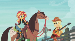 Size: 854x470 | Tagged: applejack, canter girls, country applejack, equestria girls, friendship through the ages, guitar, horse, humans riding horses, lonestar, riding, safe, screencap, sitting, sleeveless, smiling, sunset shimmer