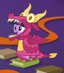 Size: 296x340 | Tagged: safe, screencap, twilight sparkle, alicorn, uncommon bond, board game, book, cute, dragon costume, dragon pit, female, solo, twiabetes, twilight sparkle (alicorn)