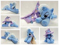 Size: 1024x768 | Tagged: safe, artist:equinepalette, trixie, pony, unicorn, beanie (plushie), cape, clothes, female, hand, hat, irl, mare, photo, plushie, prone, solo, trixie's cape, trixie's hat
