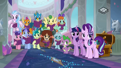 Size: 1024x576 | Tagged: safe, screencap, berry blend, berry bliss, gallus, huckleberry, november rain, ocellus, peppermint goldylinks, sandbar, silverstream, smolder, spike, starlight glimmer, twilight sparkle, yona, alicorn, changedling, changeling, classical hippogriff, dragon, earth pony, griffon, hippogriff, pegasus, pony, unicorn, yak, the end in friend, background pony, boomerang (tv channel), dragoness, female, flying, friendship student, male, mouth hold, student six, teenager, twilight sparkle (alicorn), winged spike