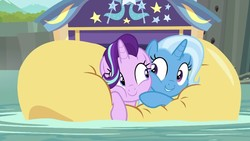Size: 1280x720 | Tagged: safe, screencap, starlight glimmer, trixie, pony, unicorn, road to friendship, cheek squish, cheek to cheek, cute, diatrixes, duo, duo female, eye contact, female, friendshipping, ghastly gorge, glimmerbetes, i guess we're stuck together, inflatable, inflatable raft, looking at each other, mare, prone, raft, river, shipping fuel, smiling, snuggling, squished, squishy, squishy cheeks, trixie's wagon, water, we're friendship bound