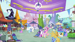 Size: 1280x720 | Tagged: safe, screencap, amethyst star, cloud kicker, orange blossom, ponet, prim posy, serena, sparkler, star swirl the bearded, warm front, alicorn, earth pony, pegasus, pony, unicorn, three's a crowd, background pony, banner, bell, cloak, clothes, costume, fair, fake beard, female, hat, male, mare, stallion, star swirl the bearded costume, wizard hat