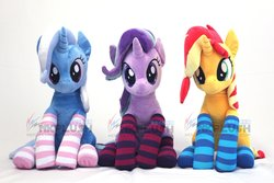 Size: 1200x800   Tagged: safe, artist:nekokevin, starlight glimmer, sunset shimmer, trixie, pony, unicorn, series:nekokevin's glimmy, clothes, counterparts, cute, female, irl, looking at you, magical trio, mare, photo, plushie, sitting, smiling, socks, striped socks, trio, twilight's counterparts, watermark