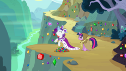 Size: 1440x810 | Tagged: burlap, cape, cliff, clothes, clover the clever, crown, duo, eyes closed, female, gem, glowing horn, gorge, hearth's warming eve (episode), hood, jewelry, magic, mare, mountain, pony, princess platinum, rarity, rearing, regalia, river, safe, screencap, smiling, telekinesis, twilight sparkle, unicorn, unicorn twilight