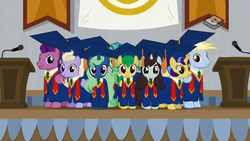 Size: 1024x576 | Tagged: safe, screencap, desert wind, fast break, flowerescent, lightning riff, rosy pearl, sprout greenhoof, sweet buzz, wintergreen, pony, friendship university, background pony, boomerang (tv channel), graduation cap, hat, las pegasus resident