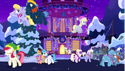Size: 1680x947 | Tagged: safe, screencap, burning passion, cherry cola, cherry fizzy, cloud kicker, derpy hooves, heart pacer, lightning bolt, love sketch, mayor mare, millie, roseluck, star hunter, strawberry swing, white lightning, earth pony, pegasus, pony, best gift ever, background pony, christmas, christmas lights, earmuffs, female, flying, hearth's warming tree, holiday, male, mare, night, ponyville, ponyville town hall, snow, stallion, the true gift of gifting, town hall, tree, winter