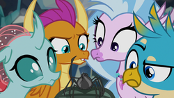 Size: 1280x720 | Tagged: safe, screencap, gallus, ocellus, silverstream, smolder, spindle, yona, changedling, changeling, classical hippogriff, dragon, griffon, hippogriff, spider, yak, what lies beneath, bow, cloven hooves, dragoness, female, hair bow, hoof hold, jewelry, monkey swings, necklace, raised eyebrow, waving