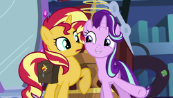 Size: 1920x1080 | Tagged: safe, screencap, starlight glimmer, sunset shimmer, pony, unicorn, equestria girls, mirror magic, spoiler:eqg specials, confused, cute, duo, excited, eye contact, female, glimmerbetes, grin, happy, library, looking at each other, mare, mirror, open mouth, raised hoof, saddle bag, smiling, twilight's castle, underhoof