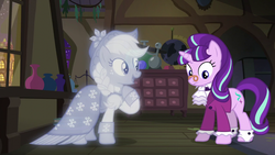 Size: 1280x720 | Tagged: a hearth's warming tail, applejack, earth pony, female, freckles, mare, pony, raised hoof, safe, screencap, smiling, snowfall frost, spirit of hearth's warming past, starlight glimmer, unicorn, window
