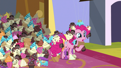 Size: 1920x1080 | Tagged: canterlot, cupcake, earth pony, female, food, frosting, mare, messy, pinkie pie, pony, raised hoof, safe, screencap, solo, spoiler:s09e24, sprinkles, the ending of the end