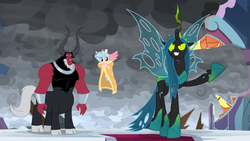 Size: 1366x768 | Tagged: safe, screencap, cozy glow, lord tirek, queen chrysalis, alicorn, centaur, changeling, changeling queen, pony, the ending of the end, spoiler:s09e25, alicornified, blanket, bow, bracer, broken, cloud, cloudy, cloven hooves, cold, cozycorn, dark clouds, female, filly, flying, hair bow, losers club, male, nose piercing, nose ring, piercing, race swap, shattered, stained glass, trio, unamused