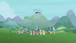 Size: 1366x768 | Tagged: safe, screencap, applejack, flash magnus, fluttershy, gallus, meadowbrook, mistmane, ocellus, pinkie pie, rainbow dash, rarity, rockhoof, sandbar, silverstream, smolder, somnambula, spike, star swirl the bearded, twilight sparkle, yona, alicorn, dragon, the ending of the end, spoiler:s09e25, crowd, hill, mane six, mountain, pillars of equestria, student six, twilight sparkle (alicorn), winged spike