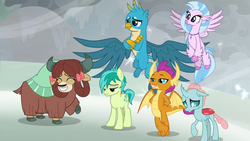 Size: 1280x720 | Tagged: safe, screencap, gallus, ocellus, sandbar, silverstream, smolder, yona, changedling, changeling, classical hippogriff, dragon, earth pony, griffon, hippogriff, pony, yak, the ending of the end, arm behind back, best friends, blizzard, claws, cloven hooves, crossed arms, crossed legs, curved horn, cute, diaocelles, diastreamies, dragoness, eyes closed, female, final battle, flying, grin, hair bow, horn, horns, jewelry, lidded eyes, looking down, male, monkey swings, necklace, pearl necklace, raised hoof, smiling, smugder, snow, snowfall, spread wings, student six, talons, teenaged dragon, teenager, unshorn fetlocks